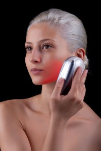 woman using red light therapy for skin rejuvenation